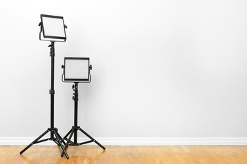 Two led lamps standing on the floor. Video light. Wall mural