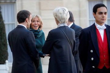 French President Emmanuel Macron and his wife Brigitte Macron welcome Quebec Prime Minister Francois Legault and his wife Isabelle Brais at the Elysee Palace in Paris