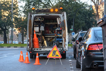 Valencia, Spain - January 16, 2019: Road maintenance van parked on a city street with cones.