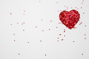 Heart shape made with glitter on white background useful for graphic projects for Valentine's Day and other love celebrations