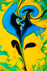 Abstract yellow multicolored background green blue view macro paint acrylic underwater ultra drop blob drip flower