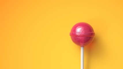 Sweet lollipop on bright yellow background with copy space