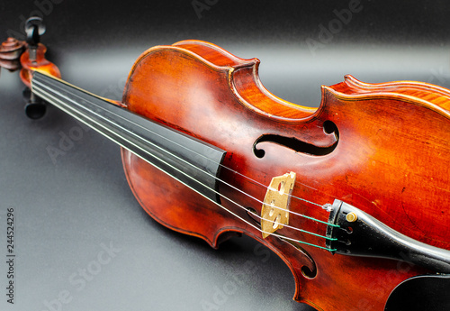 Professional violin in a dynamic position slightly tilted to