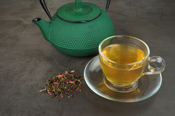 White tea with cranberry fruits and cast iron teapot
