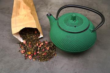 White tea with cranberry fruits  and cast iron tea pot