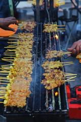 Thai street food. Pork Satay, Grilled spices pork on Charcoal stove