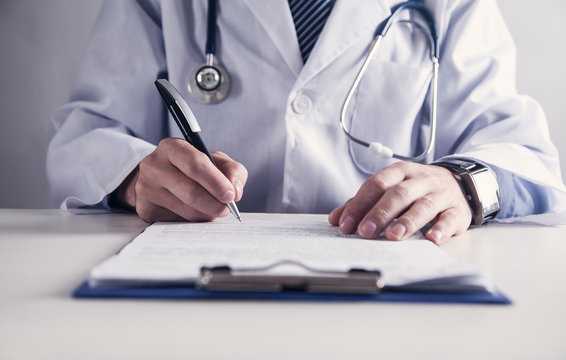 Doctor working in medical office. Medical and healthcare concept