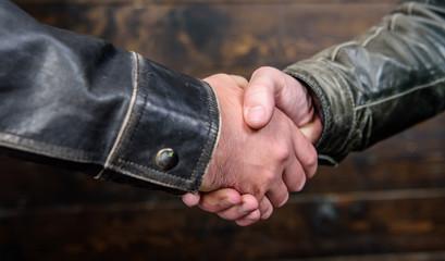Handshake gesture concept. Partnership and business deal. Successful deal handshake. Handshake approving sign. Agreement compromise arrangement. Shaking hands close up. Handshake friendly gesture