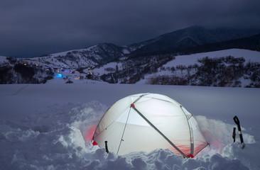 Tourist tent in night winter mountains. Carpathians