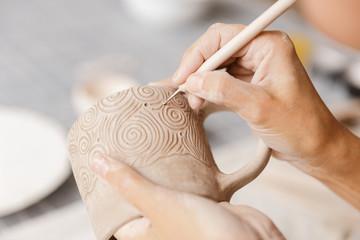 Obraz Close up of a woman making ceramic and pottery - fototapety do salonu
