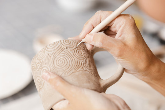 Close up of a woman making ceramic and pottery