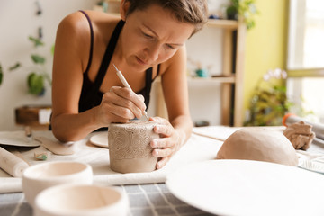 Young woman ceramic and pottery products