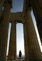 A visitor admires the temple of the Parthenon from inside in Athens.