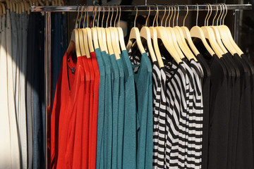 clothes rack with a selection of sweater fashion for women