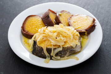 boiled fish with onion and sweet potato on white dish