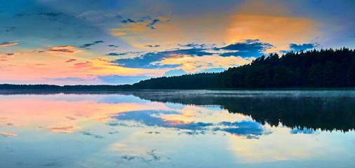 Obraz Beautiful panoramic view of the sunset over Lemiet lake in Mazury district, Poland. Fantastic travel destination. - fototapety do salonu