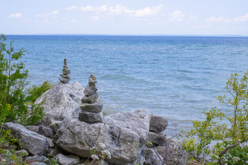 Rock Cairns On The Beach. Rock cairns on the rocky shoreline of Lake Huron on Mackinaw Island Michigan.