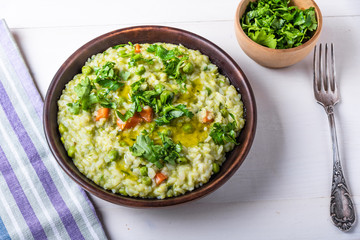 Traditional Italian vegetarian risotto with peas in rustic style