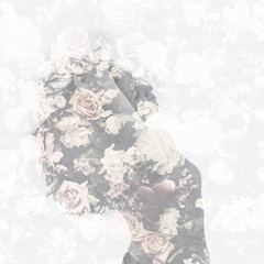 Double exposure with female portrait and vintage flower pattern.