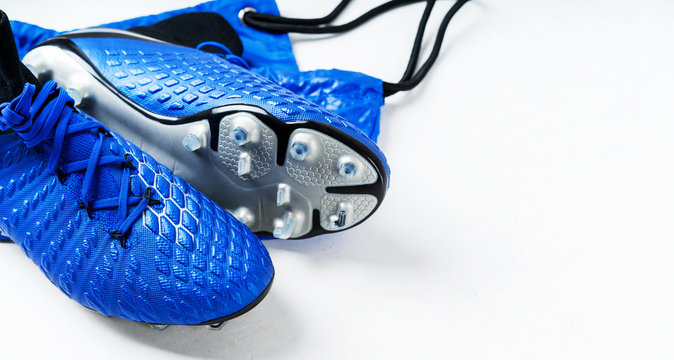 Pair of football soccer boots cleats shoes on a white background. Frame Football theme Long wide banner with copy space background.