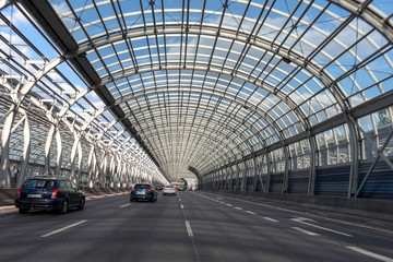 Expressway in Warsaw. Glass tunnel on the highway