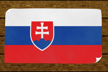 Illustration of a Slovakian flag on the paper pasted on the woody wall