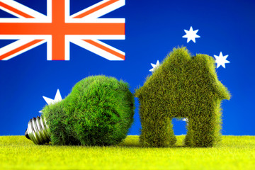 Green eco light bulb, eco house icon and Australia Flag. Renewable energy. Electricity prices, energy saving in the household.