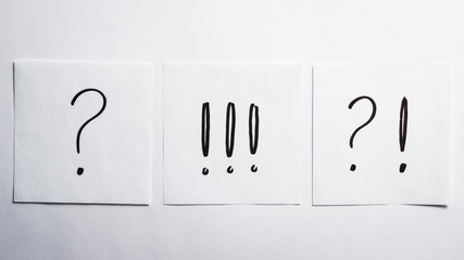 Exclamation and question marks on the paper;