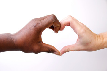 Hands make heart form, Valentines day and a picture with a message saying no to Discrimination