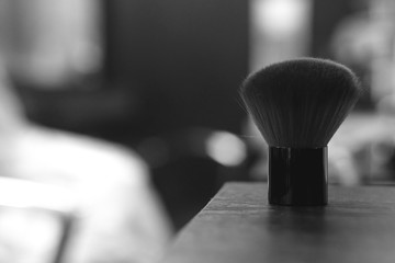 closeup of whisk, cosmetic brush, beauty salon concept background. tools in details, black and white