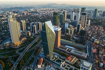 ISTANBUL, TURKEY - AUGUST 23: Skyscrapers and modern office buildings at Levent District. With Bosphorus background. August 23, 2014 in Istanbul, Turkey.