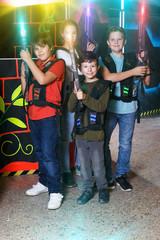 Kids posing with laser pistols
