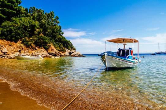 Traditional colorful boats in old town of Skiathos island, Sporades, Greece.