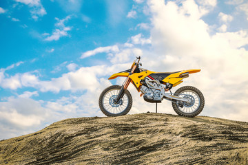 Yellow racing motorcycle on the motocross track. The off the road. 3d