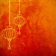 Red and gold abstract textured background with chinese lanterns.  Lunar new year artistic wallpaper.
