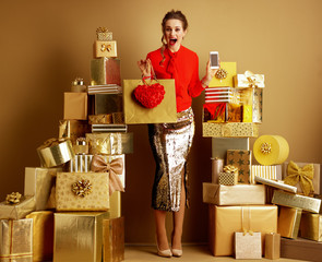shopper woman with shopping bag, red heart and smartphone