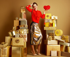 cheerful stylish woman with red heart