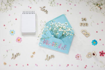 Brunches of Beautiful Gypsophila Flower on White Wooden Valentine Background with Copy Space. Concept: Valentine Day Surprise.