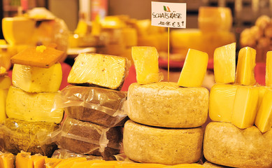 cheese laid out for sale on market stall