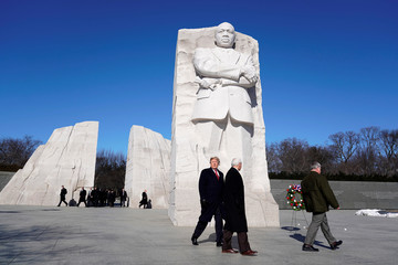 U.S. President Donald Trump and U.S. Vice President Mike Pence pause after placing a wreath at the Martin Luther King Memorial in Washington