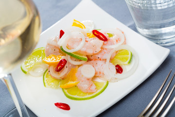 Ceviche with shrimps, lime, orange
