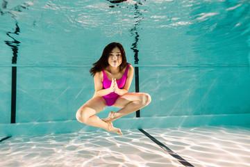 beautiful woman posing underwater in swimming pool
