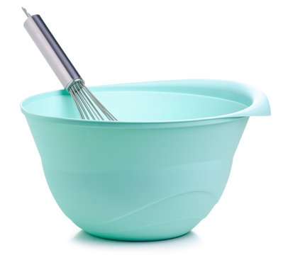 Green bowl and kitchen whisk corolla on white backgrund isolation