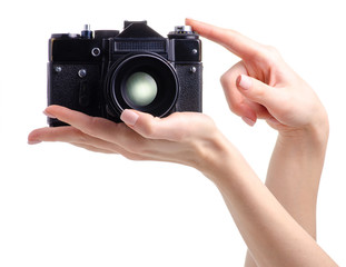 Photo camera old in hands on white background isolation