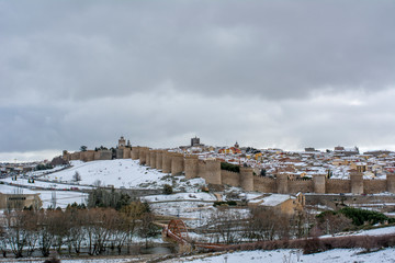 covered with snow panorama of the city of Avila, Spain