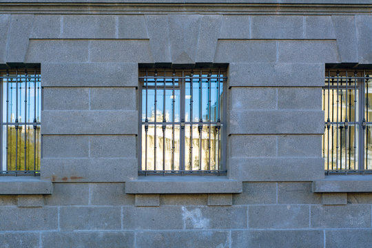 Wall of the building with barred windows