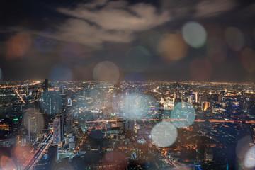 ฺNight scene of Bangkok cityscape with skyscraper and curve of Chao Praya river in the far background with Bokeh effect for nightlife concept / Cityscape concept / Nightlife