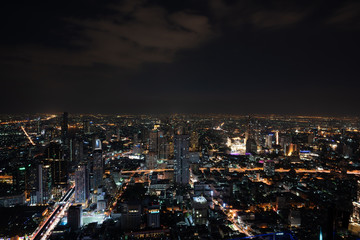 ฺNight scene of Bangkok cityscape with skyscraper and curve of Chao Praya river in the far background with Bokeh effect for nightlife concept / Cityscape concept / Nightlife