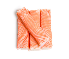 Crab sticks, krab sticks, imitation crab meat or seafood sticks. Isolated on white.