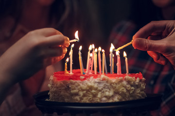 Detailed view of a white birthday cake with candle